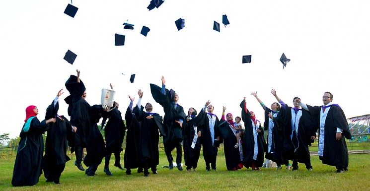 Graduates celebrating after the 2nd Convocation of Leading University was held. Photo Credit: Forhad Kamaly